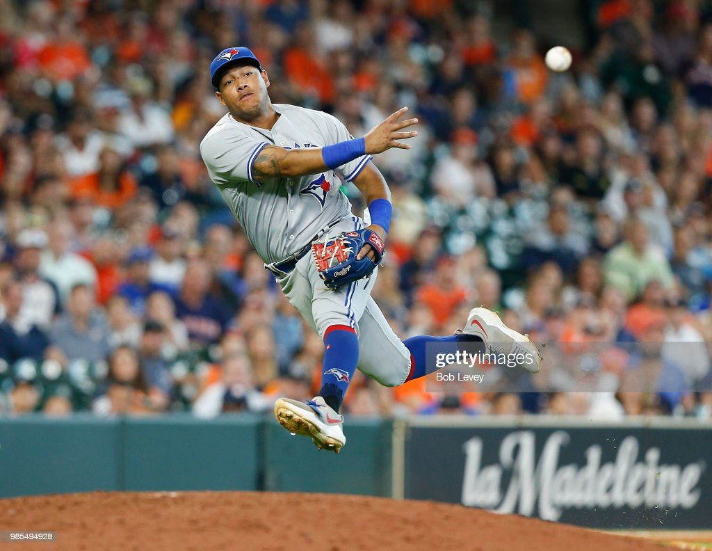 Yangervis Solarte #26 of the Toronto Blue Jays throws after fielding a slow rolling ground ball off the bat of Jose Altuve of the Houston Astros in the seventh inning at Minute Maid Park on June 27, 2018 in Houston, Texas. Altuve was safe on the play.