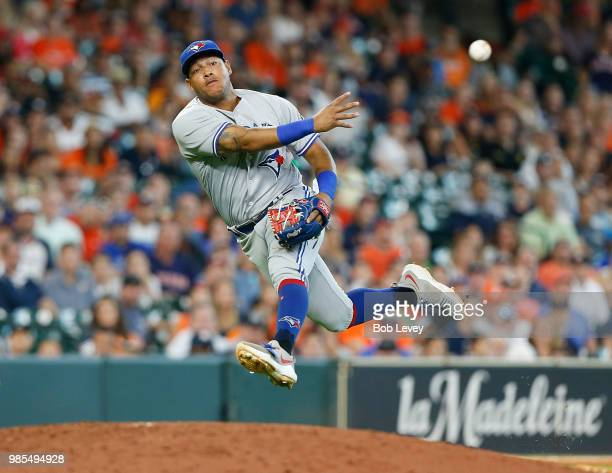 Yangervis Solarte of the Toronto Blue Jays throws after fielding a slow rolling ground ball off the bat of Jose Altuve of the Houston Astros in the...