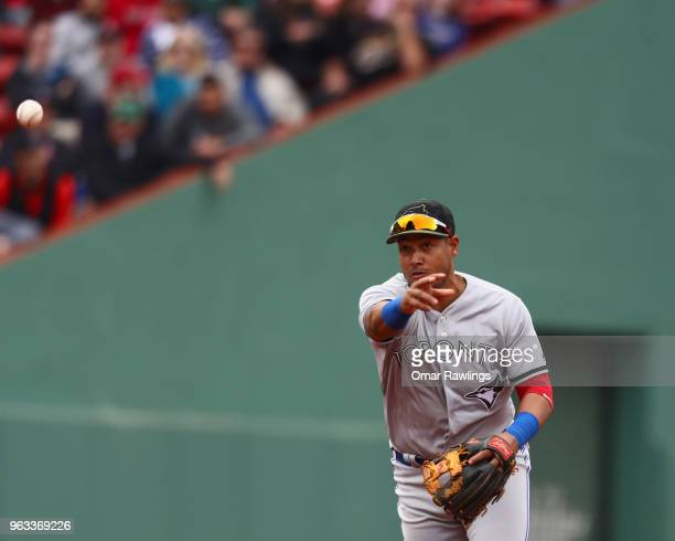 Yangervis Solarte of the Toronto Blue Jays throws to first base in the bottom of the eighth inning of the game against the Boston Red Sox Fenway Park...