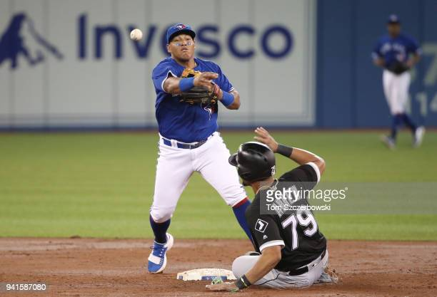 Yangervis Solarte of the Toronto Blue Jays turns a double play in the third inning during MLB game action as Jose Abreu of the Chicago White Sox...