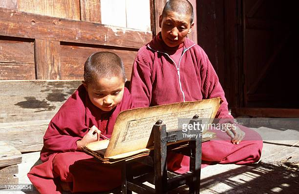 Yanghin an 8year old child nun studies the sacred Tibetan books under the supervision of Tahsi her guru at the Sin Sur monastery