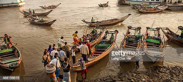 Yangon, Myanmar Jan 11 - Many workers cross Yangon river every day using small ferry boats and Ship between Yangon city and Dala