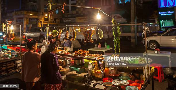 Yangon , Myanmar Jan 12 - Hawkers selling food in the street Yangon Chinatown was created when the British expanded the city in the 1850s. It lies...