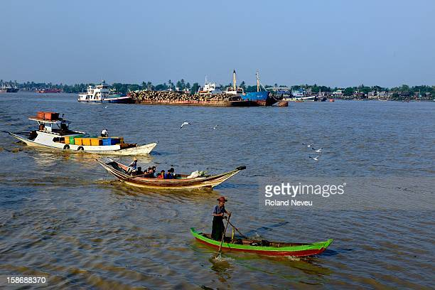 Yangon RIver in the morning where big and small boats can be encountered