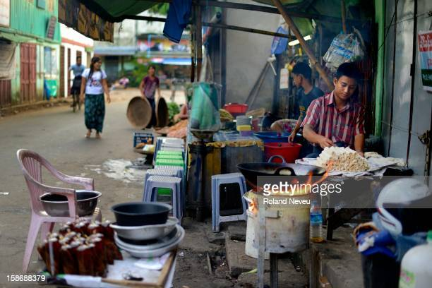 Yangon street life during November 2012. The vibrant activity is seen everywhere on the street, food, commerce cooking happen all over the former...