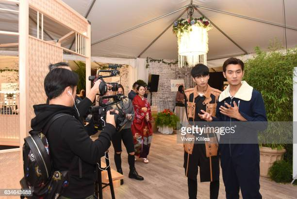 Yangyang Zhang and Tian Yu attend GRAMMY Gift Lounge during the 59th GRAMMY Awards at STAPLES Center on February 10 2017 in Los Angeles California