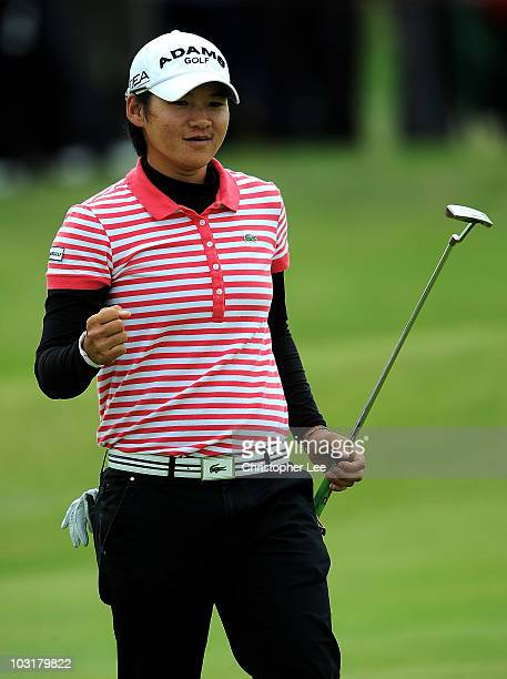 Yani Tseng of Taiwan celebrates holing a birdie putt on the 13th green during the third round of the 2010 Ricoh Women's British Open at Royal...