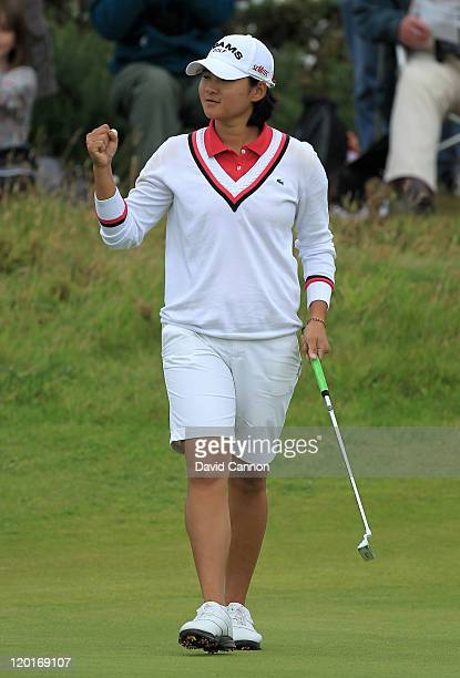 Yani Tseng of Taiwan celebrates holing a birdie putt on the 17th green on her way to victory during the final round of the 2011 Ricoh Women's British...