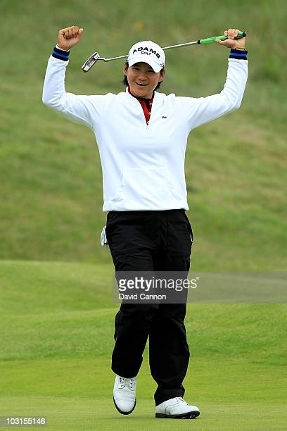 Yani Tseng of Taiwan celebrates holing an eagle putt on the 18th green during the first round of the 2010 Ricoh Women's British Open at Royal...