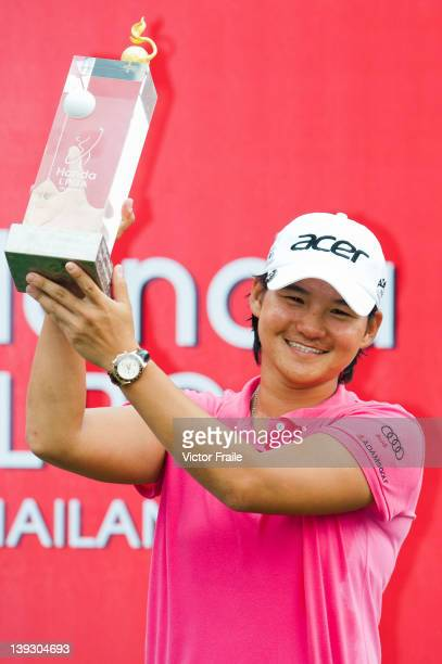 Yani Tseng of Taiwan celebrates with the trophy after winning the LPGA Thailand at Siam Country Club on February 19 2012 in Chon Buri Thailand