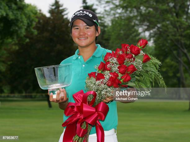 Yani Tseng of Taiwan holds the trophy after winning the LPGA Corning Classic at the Corning Country Club held on May 24 2009 in Corning New York