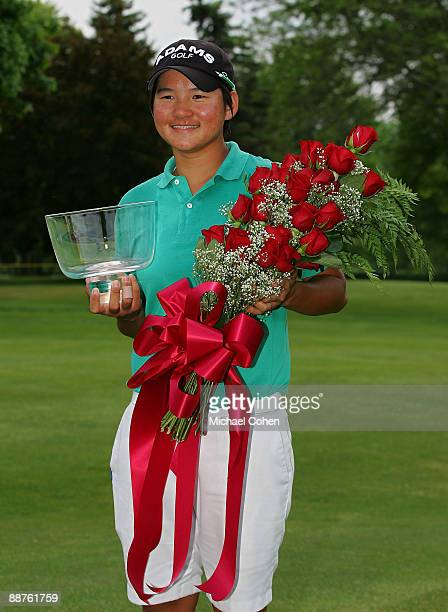 Yani Tseng of Taiwan holds the trophy and a bouquet of roses after winning the LPGA Corning Classic at the Corning Country Club held on May 24 2009...
