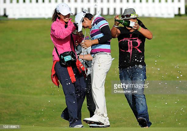 Yani Tseng of Taiwan is sprayed with champagne by Christina Kim of the USA after securing victory on the 18th green during the final round of the...