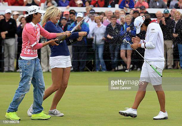 Yani Tseng of Taiwan is sprayed with champagne following her victory on the 18th green during the final round of the 2011 Ricoh Women's British Open...