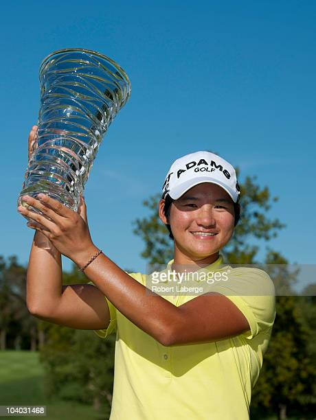 Yani Tseng of Taiwan lifts the winner's trophy after winning the PG NW Arkansas Championship at the Pinnacle Country Club on September 12 2010 in...
