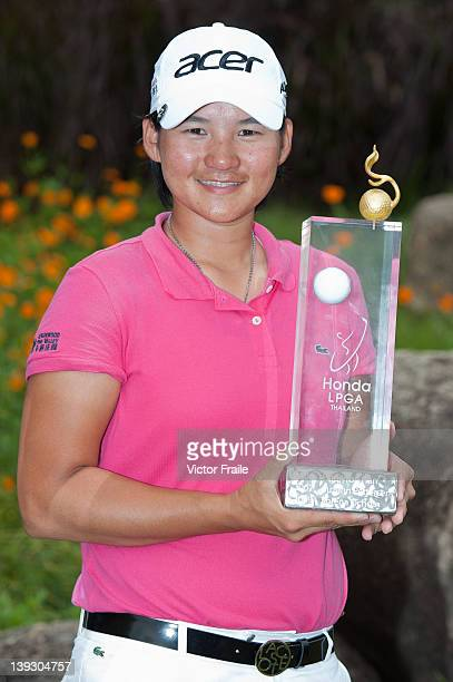 Yani Tseng of Taiwan poses with the trophy after winning the LPGA Thailand at Siam Country Club on February 19 2012 in Chon Buri Thailand