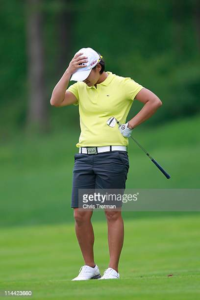 Yani Tseng of Taiwan reacts after hitting her third shot on the eleventh hole during round one of the Sybase Match Play Championship at Hamilton Farm...