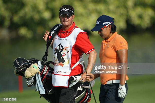 Yani Tseng of Taiwan stands with her caddie Jason Hamilton on the second hole during the third round of the HSBC Women's Champions at the Tanah Merah...