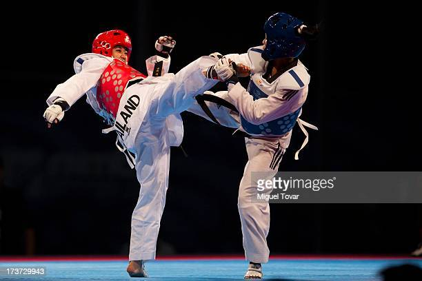 Yania Aguirre of Cuba competes with Chanatip Sonkham of Thailand during the women«s 49 kg semifinals of the WTF World Taekwondo Championships 2013 at...