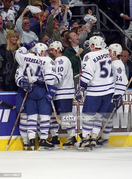 Yanic Perreault Garry Valk Alexander Karpovtsev and Bryan Berard of the Toronto Maple Leafs skate against the Pittsburgh Penguins during the 1999...