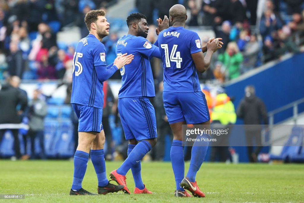 Yanic Wildschut of Cardiff City and Sol Bamba applaud the fans after the final whistle of the Sky Bet Championship match between Cardiff City and Sunderland at the Cardiff City Stadium on January 13, 2018 in Cardiff, Wales.