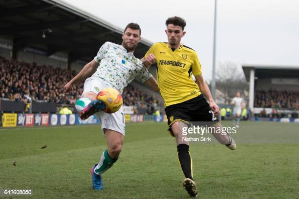 Yanic Wildschut of Norwich City and Tom Flanagan of Burton Albion in action during the Sky Bet Championship match between Burton Albion and Norwich...