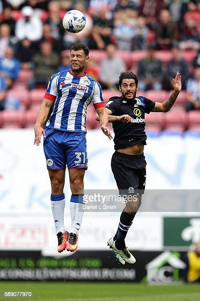 Yanic Wildschut of Wigan Athletic and Stephen Hendrie of Blackburn Rovers head the ball during the Sky Bet Championship League match between Wigan...