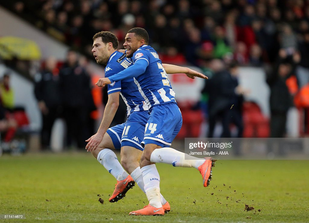 Yanic Wildschut of Wigan Athletic celebrates after scoring a goal to make it 1-2 with Reece Wabara of Wigan Athletic during the Sky Bet League One match between Walsall and Wigan Athletic at Bescot Stadium on February 20, 2016 in Walsall, England.