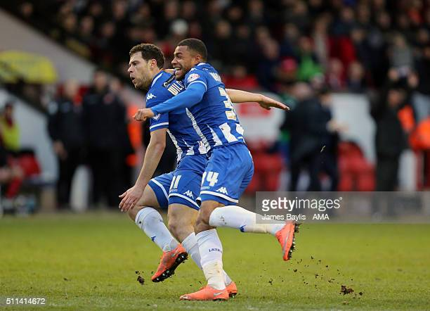Yanic Wildschut of Wigan Athletic celebrates after scoring a goal to make it 12 with Reece Wabara of Wigan Athletic during the Sky Bet League One...