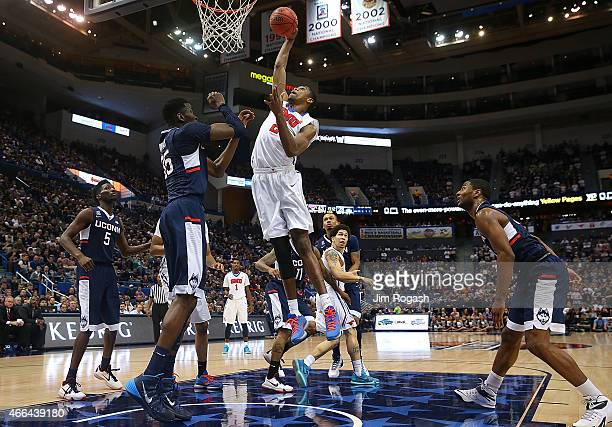 Yanick Moreira of the Southern Methodist Mustangs drives to the basket against the Connecticut Huskies in the final game of the American 2015...