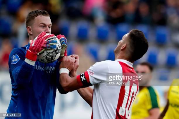 Yanick van Osch of Fortuna Sittard and Dusan Tadic of Ajax collide during the Dutch Eredivisie match between Fortuna Sittard and Ajax at Fortuna...