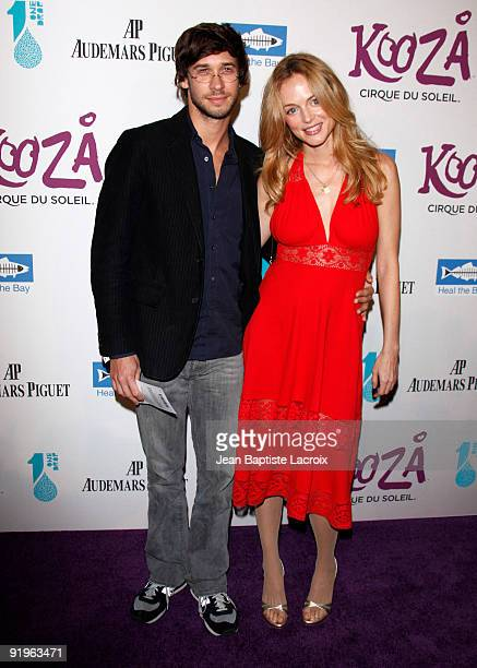 Yanif Raz and Heather Graham arrives for the Cirque Du Soleil Opening Night Gala For Kooza at Santa Monica Pier on October 16 2009 in Santa Monica...