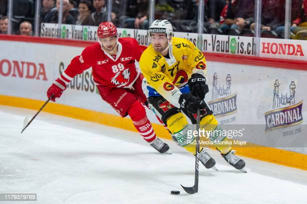 Yanik Burren of SC Bern vies with Cody Almond of Lausanne HC during the Swiss National League game between Lausanne HC and SC Bern at Vaudoise Arena...