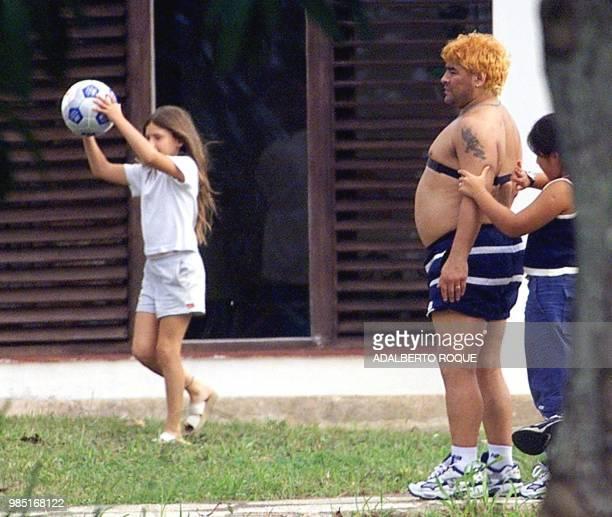 Yanina Maradona adjusts a heart monitor on her father Diego who is undergoing drug abuse treatment in Havana 26 January 2000 Yanina Maradona le...