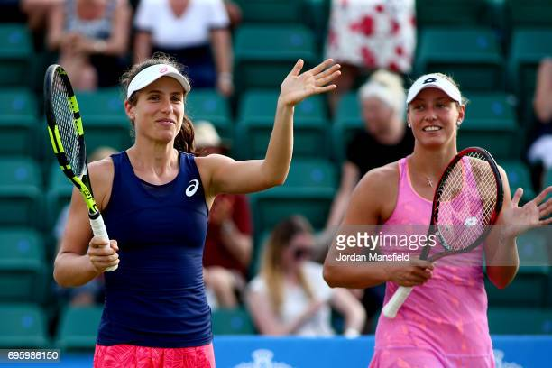 Yanina Wickmayer of Belgium and Johanna Konta of Great Britain celebrate their victory in their Women's doubles first round match against ChiaJung...