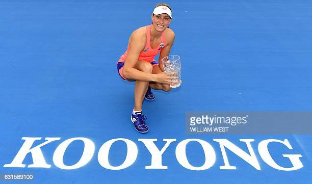 Yanina Wickmayer of Belgium holds the trophy after winning the women's final against Sorana Cirstea of Romania at the Kooyong Classic tennis...