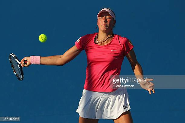 Yanina Wickmayer of Belgium plays a forehand in her first round match against Galina Voskoboeva of Kazakhstan during day one of the 2012 Australian...