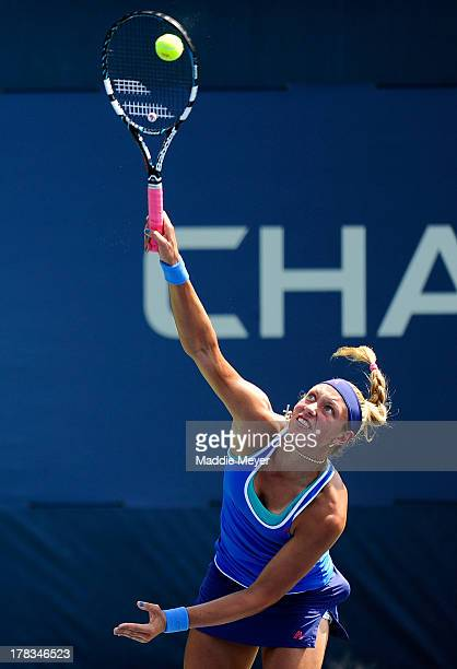 Yanina Wickmayer of Belgium serves next to her partner Sorana Cirstea of Romania during their women's doubles first round match against Casey...
