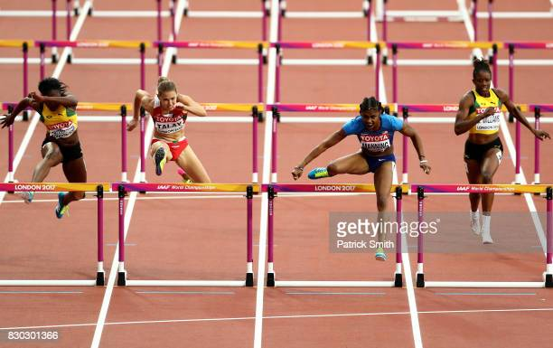 Yanique Thompson of Jamaica Alina Talay of Belarus Christina Manning of the United States and Danielle Williams of Jamaica compete in the Women's 100...