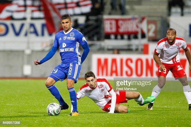 Yanis Merdji of Bourg en Bresse and Vincent Marchetti of Nancy and Tobias Badila of Nancy during the French Ligue 2 mach between Nancy and Bourg en...