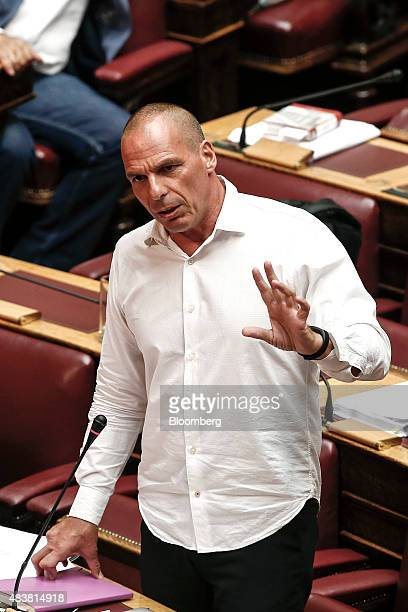 Yanis Varoufakis former Greek finance minister stands up and speaks during a parliamentary session ahead of a vote by lawmakers on a bailout deal in...