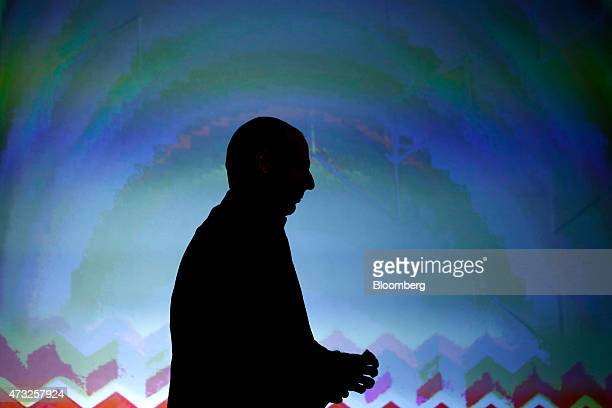 Yanis Varoufakis Greece's finance minister is silhouetted against a video screen following his speech during an annual conference sponsored by The...