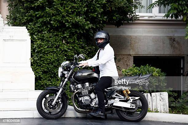 Yanis Varoufakis Greece's finance minister sits on his motorcycle outside Maximos Mansion following a cabinet meeting in Athens Greece on Sunday June...