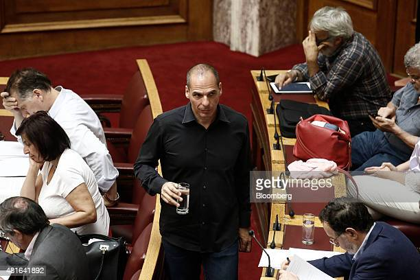 Yanis Varoufakis Greece's former finance minister center arrives at the parliament ahead of a vote on the terms of a third bailout in Athens Greece...