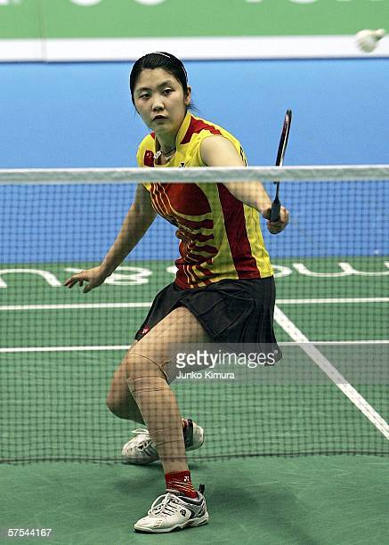 Yanjiao Jiang of China returns a shot during the finals of the YONEX Uber Cup Japan 2006 World Team Championships on May 6, 2006 in Tokyo, Japan....
