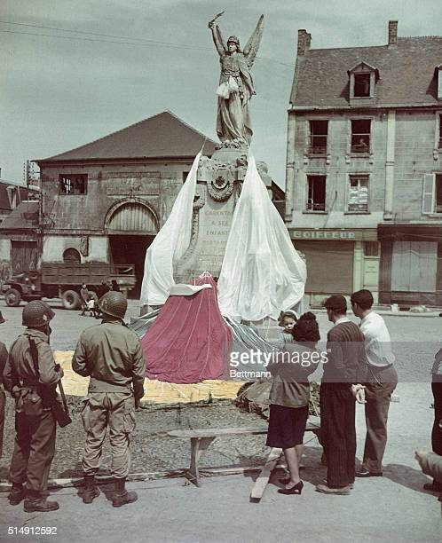 Yank 'chutes decorate French memorial Carentan France American soldiers and French civilians admire that memorial to World War I dead in Carentan...