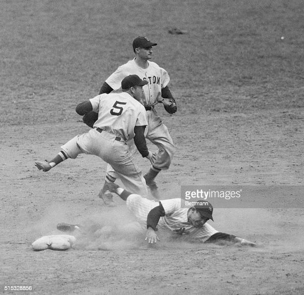 Yank Yogi Berra is erased at second on Joe DiMaggio's grounder to Boston's Bobby Doerr in the eight frame of the crucial YanksRed Sox game at Yankee...