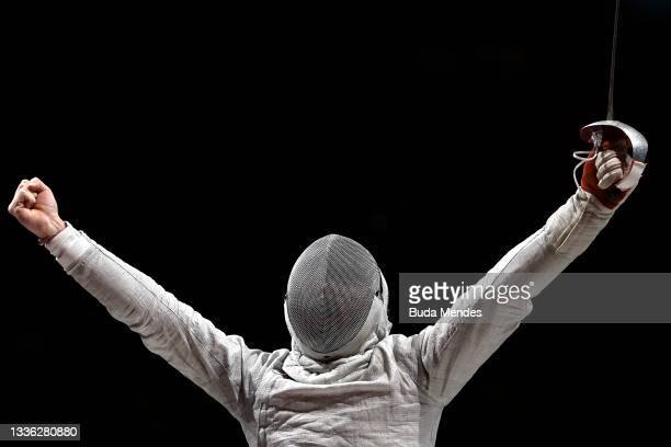 Yanke Feng of Team China celebrates a point against Adrian Castro of Team Poland during the Men's Sabre Individual Category B Final on day 1of the...