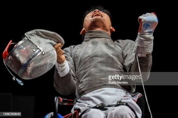 Yanke Feng of Team China celebrates the victory against Adrian Castro of Team Poland during the Men's Sabre Individual Category B Final on day 1of...