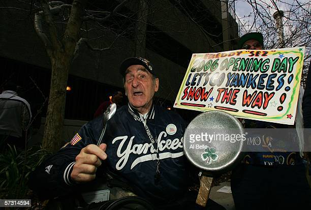 Yankee fan Freddy Sez Schuman sits outside of Yankees Stadium before the home opener against the Kansas City Royals at Yankee Stadium on April 11...